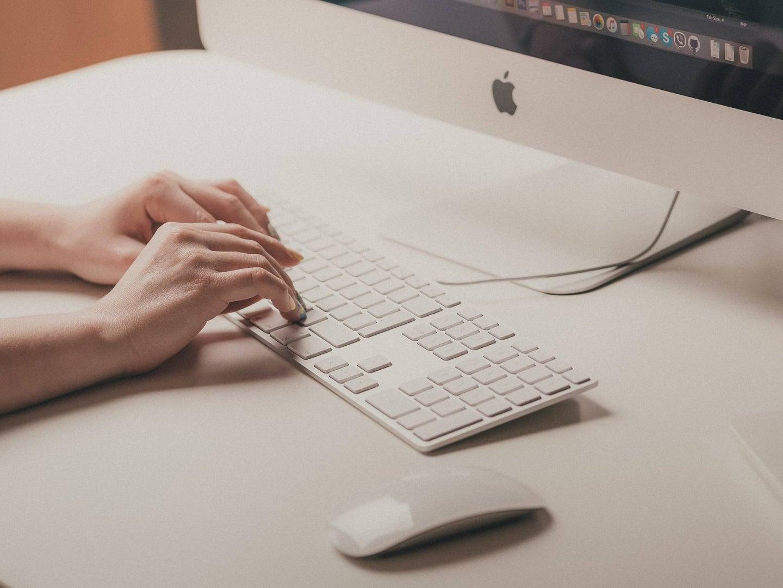 hands on a mac keyboard