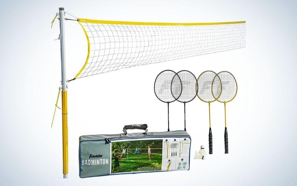 4 steel badminton rackets, birdies, 6 stakes and ropes backyard game