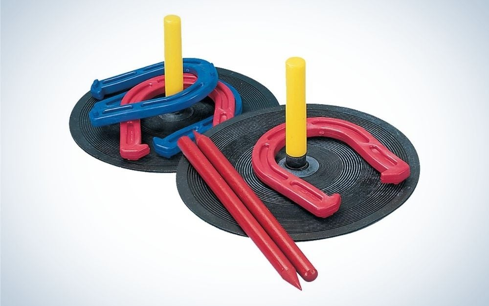 Horseshoes, mats with pegs and dowels backyard game