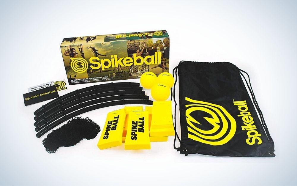Black and yellow Spikeball 3 ball kit and a carrying bag for backyard games