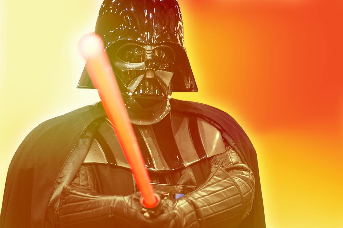 Darth Vader weilding a lightsaber