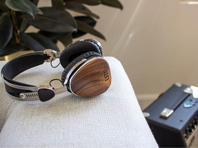 Wooden headphones on desk.