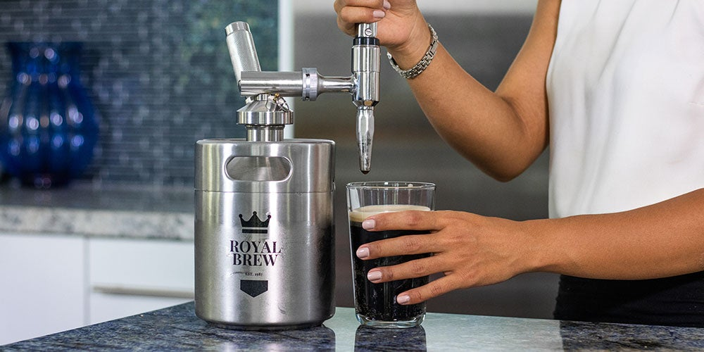 Woman pouring cold brew.