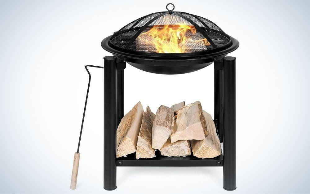 Black outdoor fire pit bowl with shelf for wood sticks