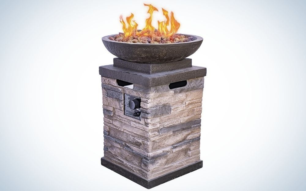 Steel outdoor fire pit with natural lava rocks