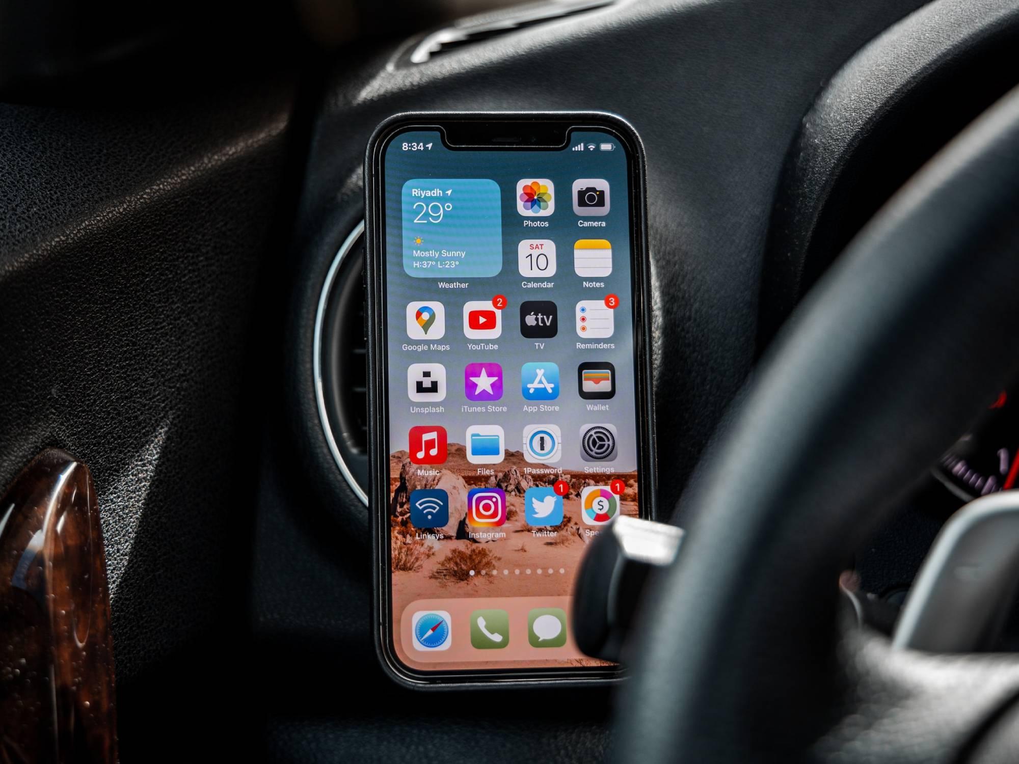 iPhone beside steering wheel in car