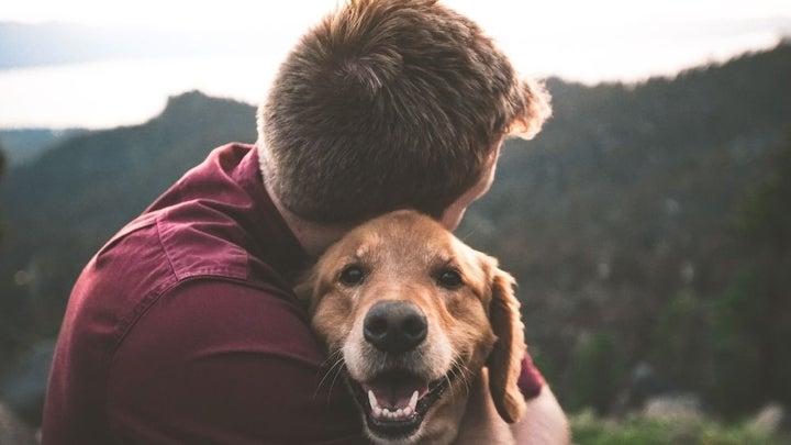 Man hugging a dog.