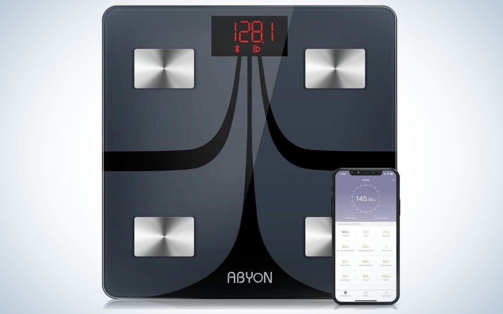 Digital home gym scale and the weight showing on it