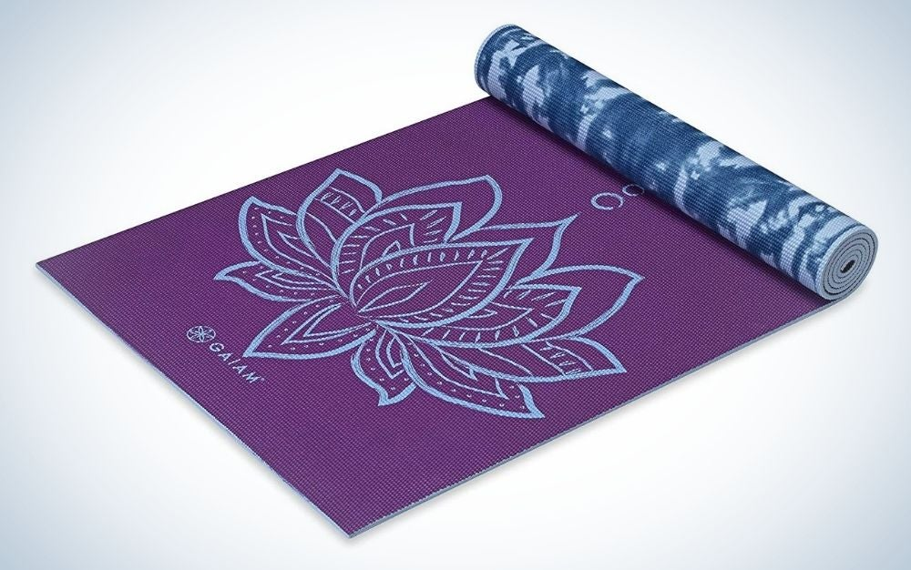 Purple lotus yoga mat with a flower in the middle