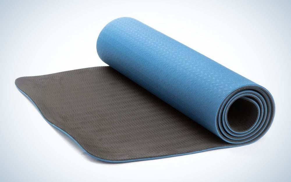 Blue and black, rolled yoga mat
