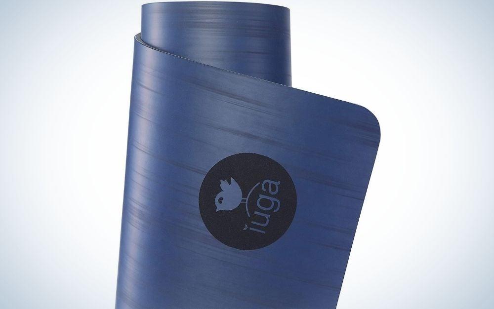Dark blue, rolled yoga mat