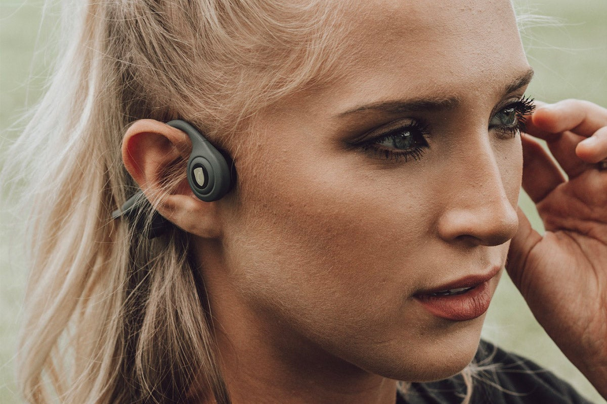 Woman with headphones on.