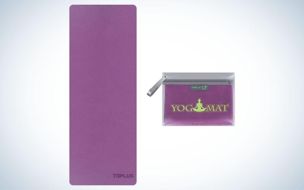 Thin, purple, foldable yoga mat