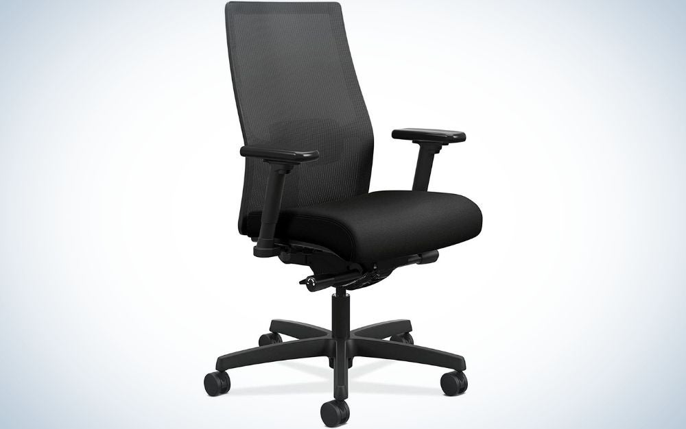 A black office chair with black sliding wheels and translucent chair support and five wheels to move more easily.