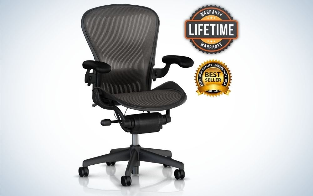 A black office chair with black sliding wheels and chair support a translucent mesh.