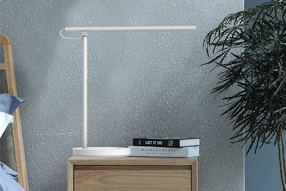 Modern lamp on side table with books