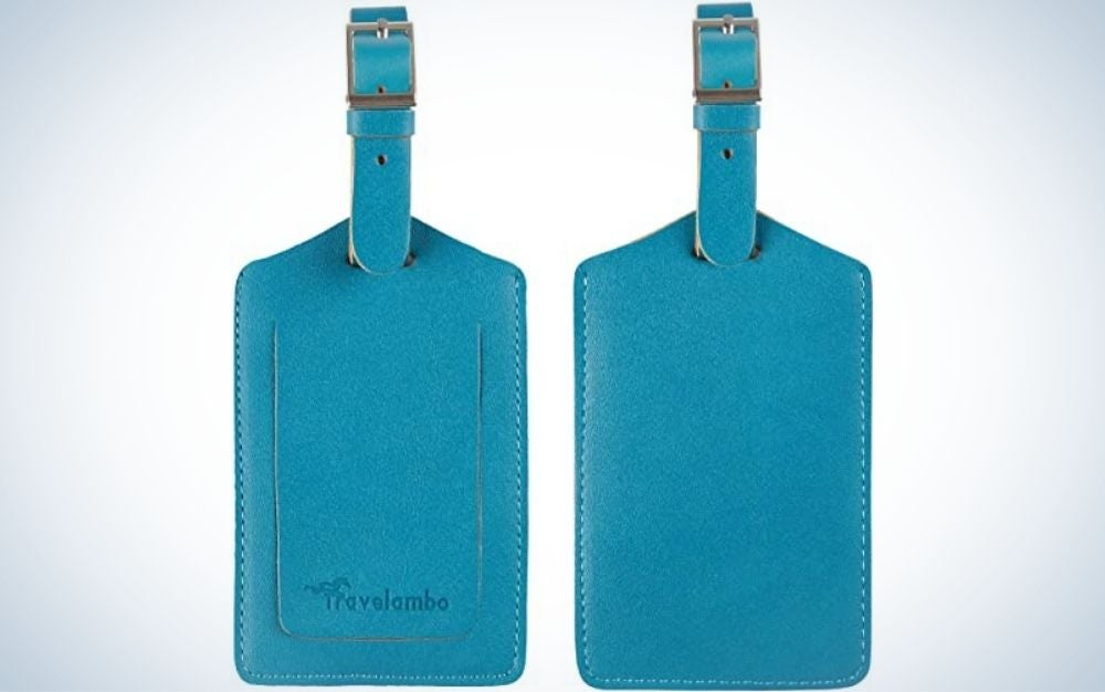 Two blue luggage tags with a head of a zipper in the top of them.