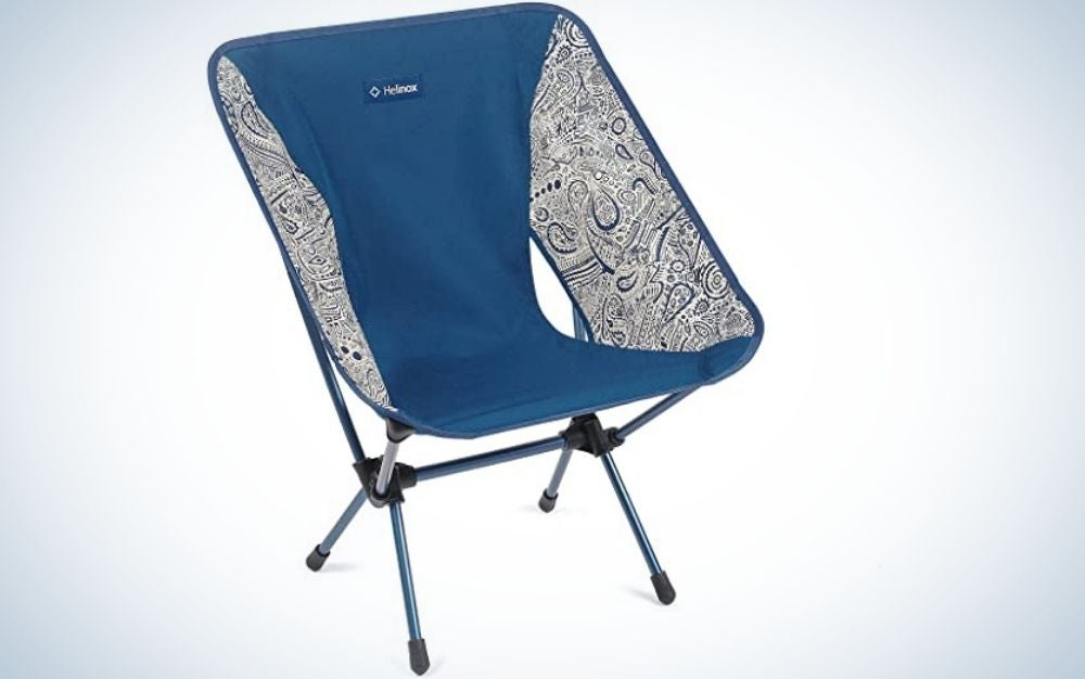 A portable blue and white chair with four metallic legs.