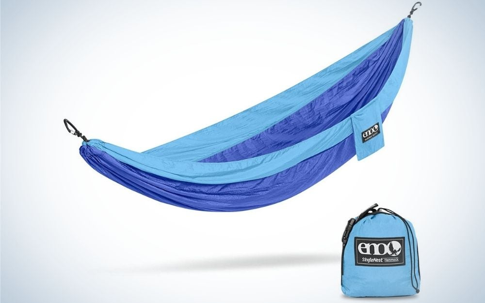 A strong and light blue color hammock in a large shape and with a small blue bag under it.