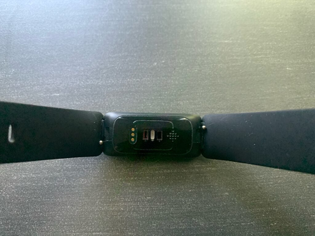 sensors on the back of a fitbit