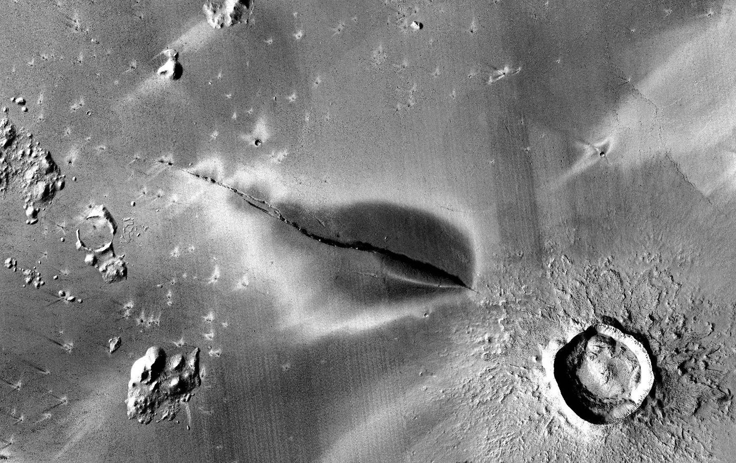 A fissure in the Cerberus Fossae formation on Mars.