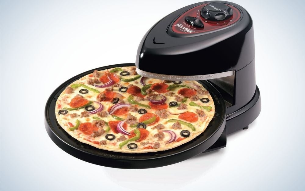 A black electric oven all with a few buttons on the top of it and with a baked pizza in it.