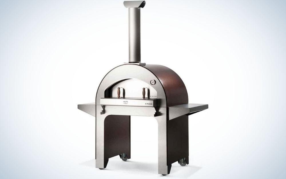 A large oven all metal and silver color, with a long chimney-shaped tube and wide from below to create space for baking that will be done in it.
