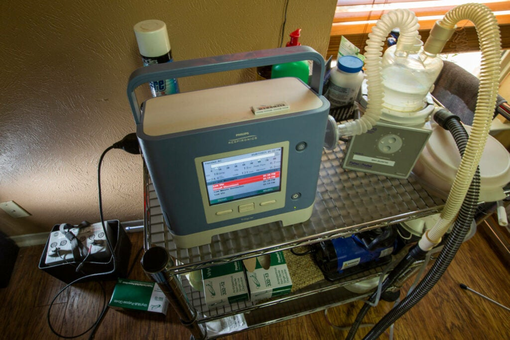 Ventilator for muscular dystrophy hooked up to back- battery in a house