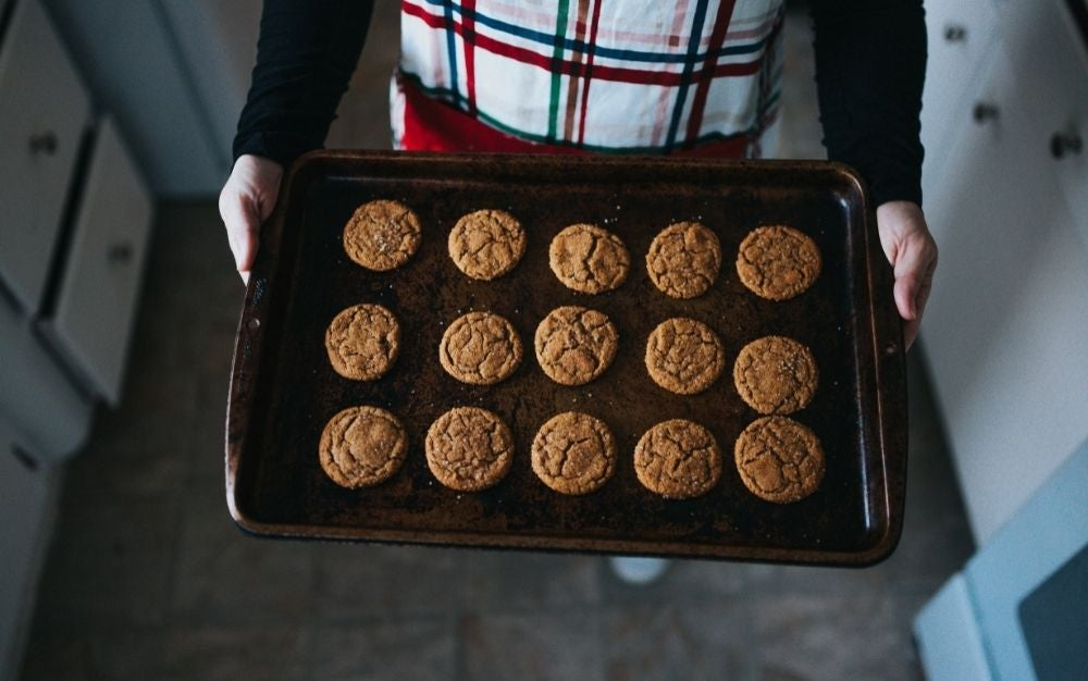 Person holding baking tray of cookies
