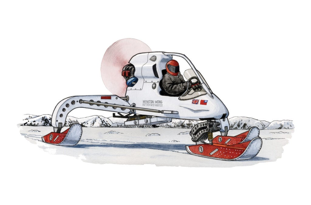 Snow mobile-like machine on three blades with person in helmet driving on tundra