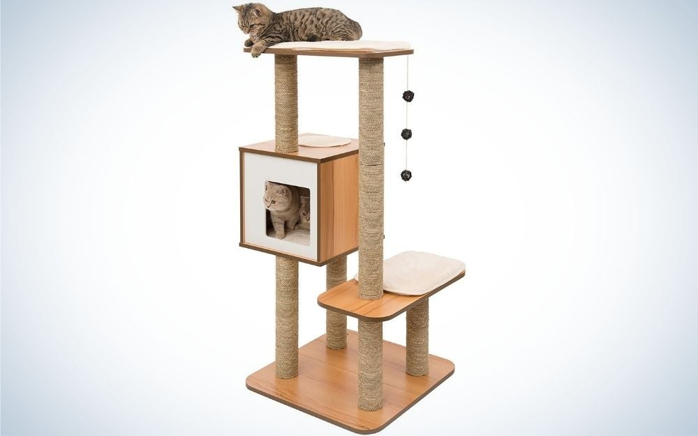 A large cat tree with a wooden material and with three floors, two just to stand or sit uncovered, and second floor is like a small box with an open door.