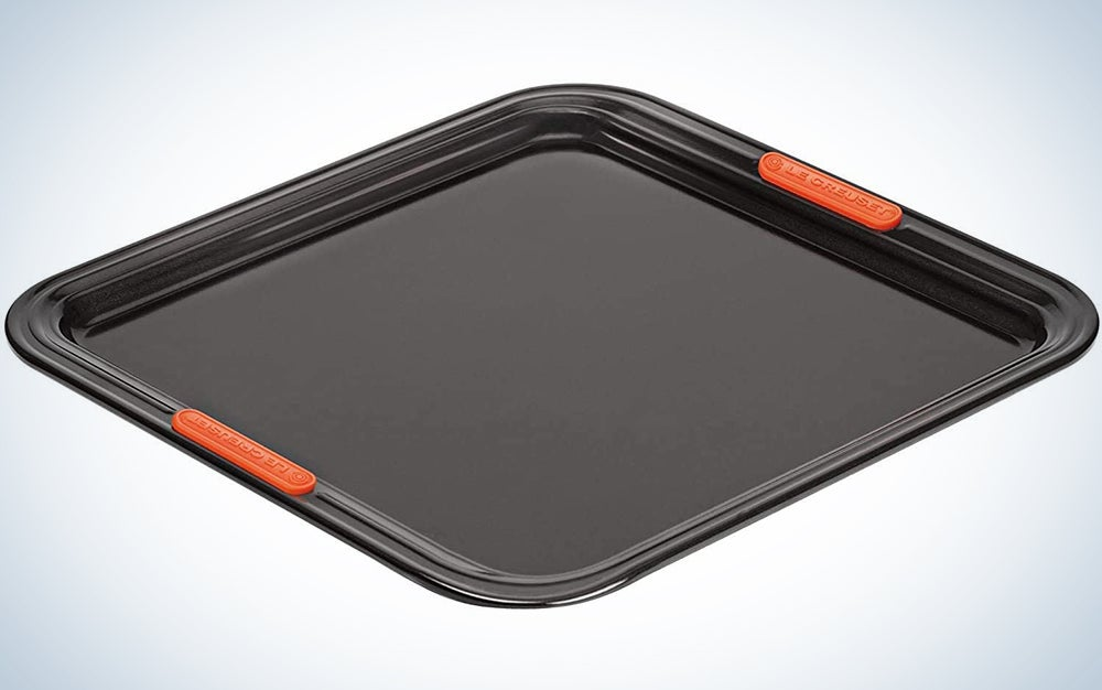 gray baking tray with orange handles built in