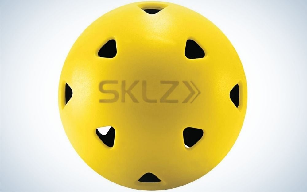 A round yellow ball with triangle black holes into it.