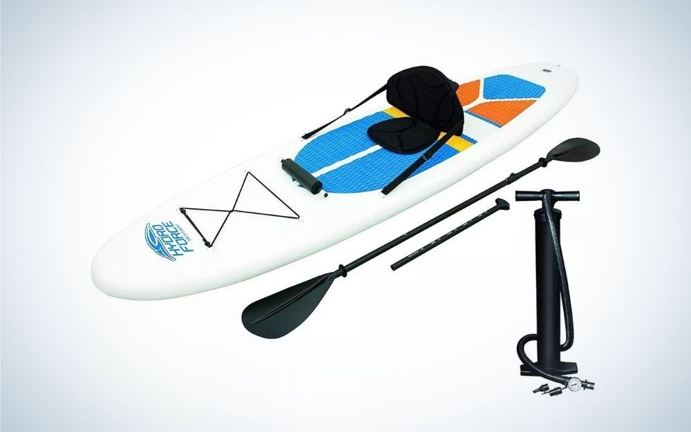 White inflatable stand-up paddleboard with black hand pump, bag, and paddles