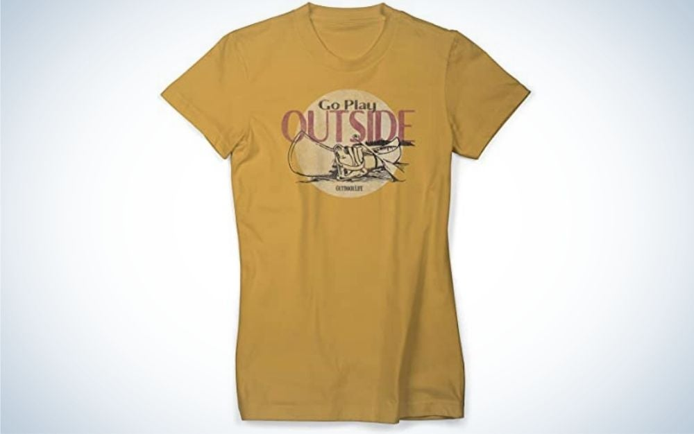 An yellow T shirt with red lettering in front of it.