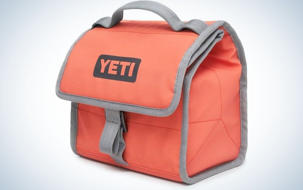 A small red bag with grey lines into it and written YETI with capital letters.