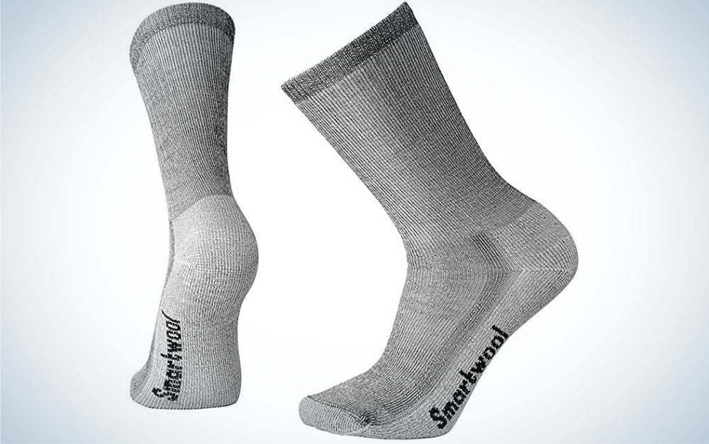 Two pair of socks in a grey color with written letters under them.