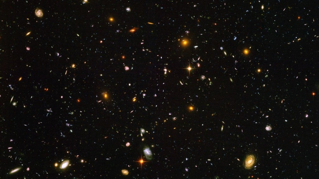 An image from the Hubble telescope showing many galaxies.