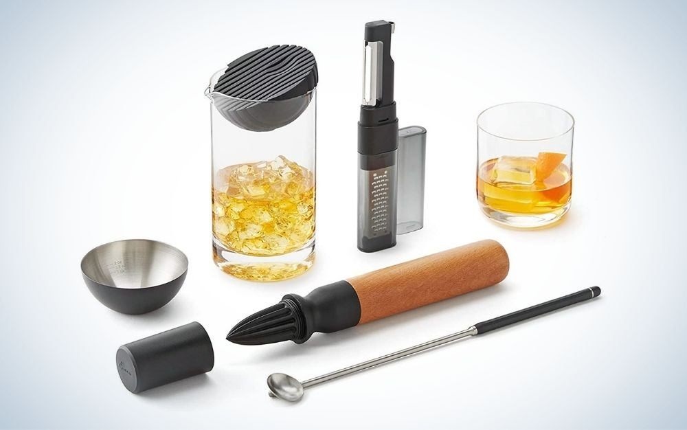 Bar tool set cocktails kit including spin spoon, muddler & reamer, silicone strainer & jigger, garnish tool, and mixing glass.