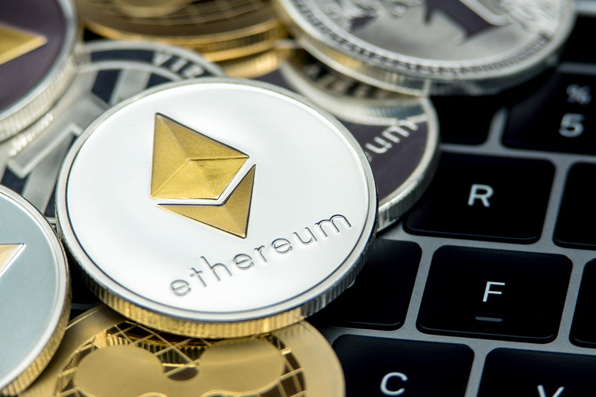 Ethereum coin on laptop keyboard.