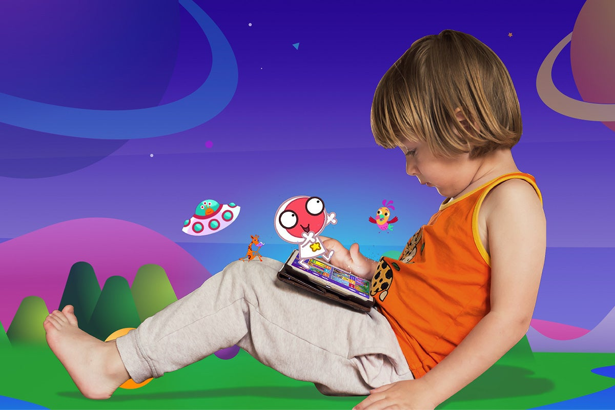Child playing on tablet with colorful cartoon background.