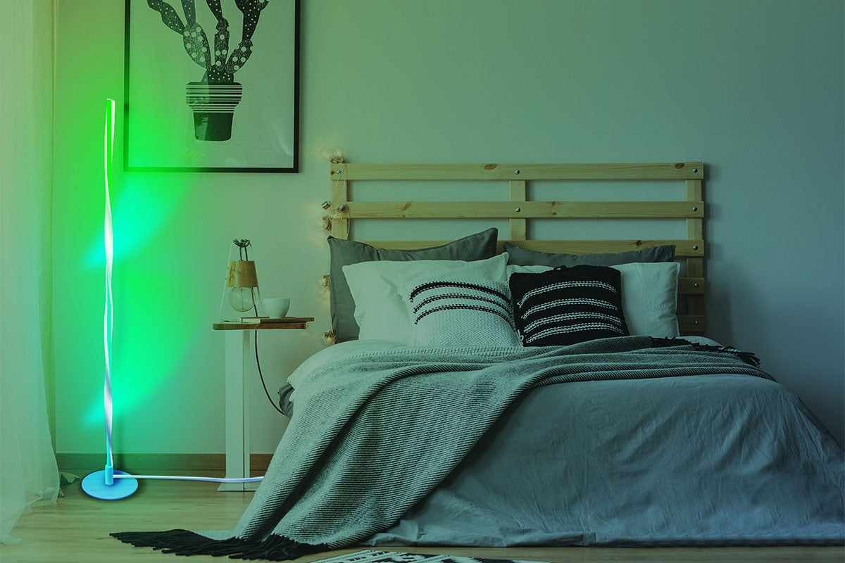 Bedroom with decorative green light.