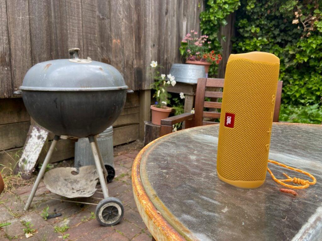 jbl flip 5 Bluetooth speaker near a grill