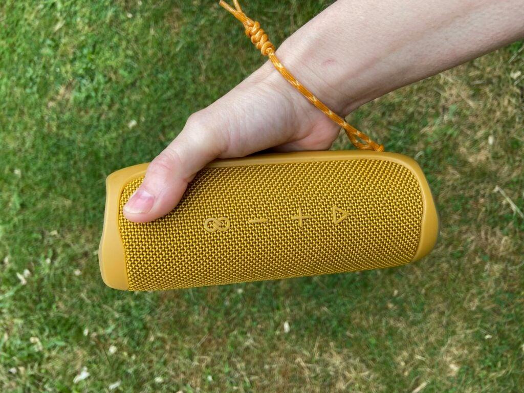 jbl flip speaker in a hand