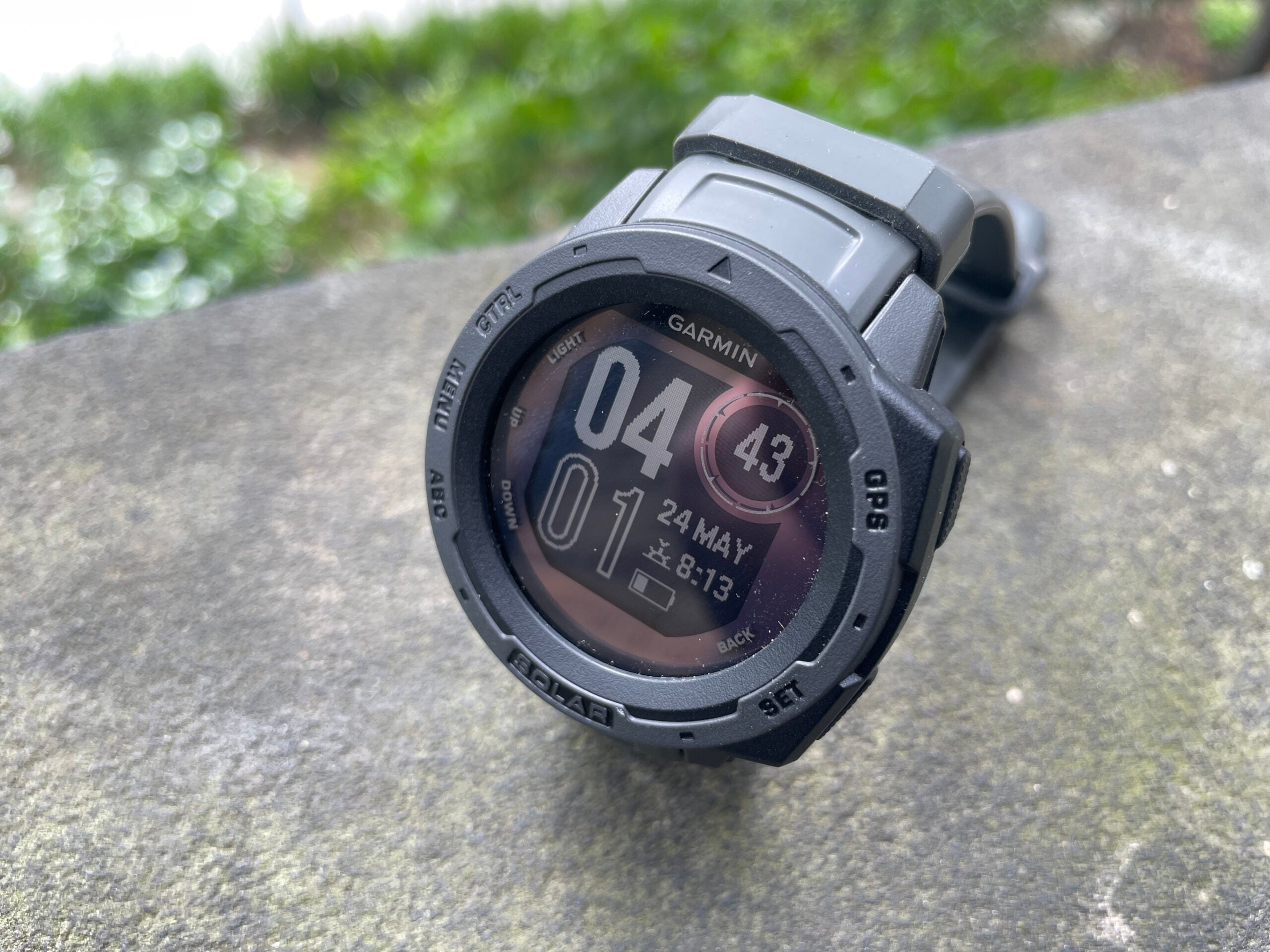 black garmin instinct solar smartwatch
