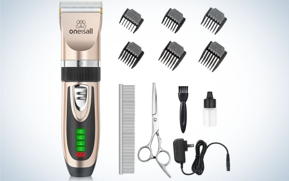 A silver colored machine for trimming dog hairs as well as any additional products that are inside the set, including the different numbers of the machine head and the scissors and comb.