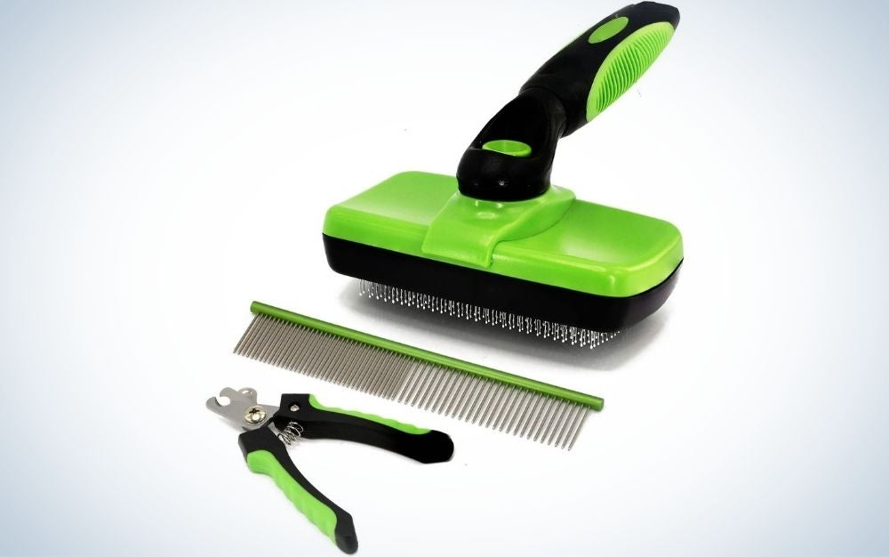 A dog and cat grooming kit in green with a black tail, as well as a pet clipper and a green comb as well.