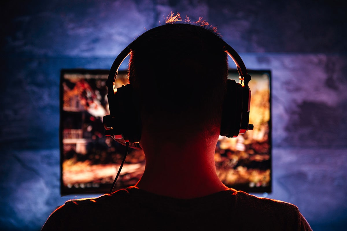 Person gaming with headphones on.