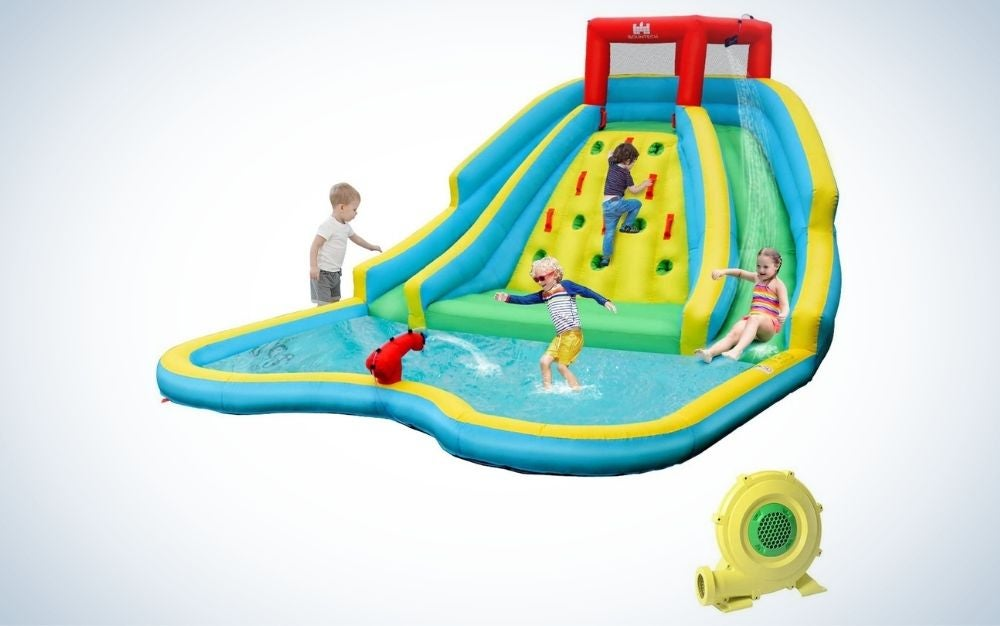 Colorful, inflatable double slide bounce pool with climbing wall