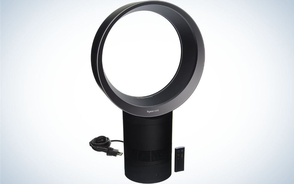 A black fan which has the top part round and with empty space inside it and the support part is in cylindrical shape.